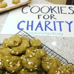 picture of matcha green tea cookies on a wire rack with a Cookies for Charity sign