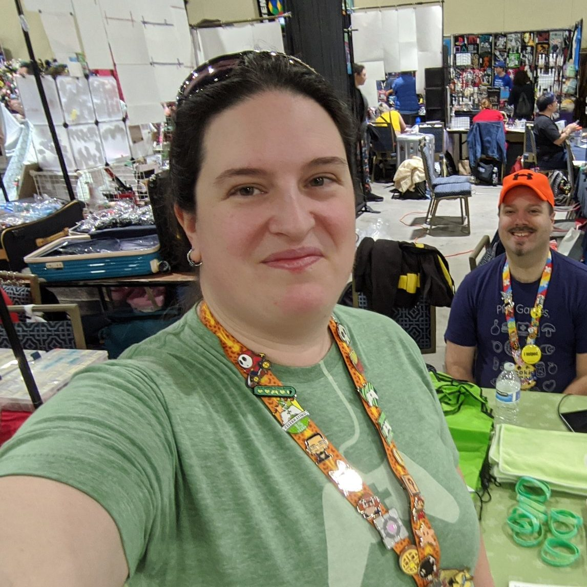 Ransim and robziel in the background posing while manning the Child's Play booth at Magfest 2020